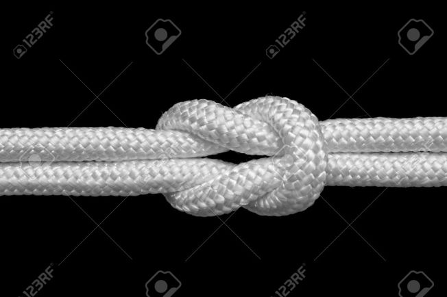 10419804-reef-or-square-knot-for-join-two-ropes-isolated-on-black-stock-photo