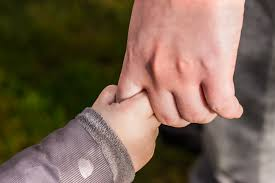holding childs hand